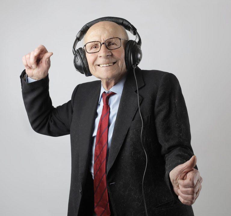 cheerful-elderly-man-listening-to-music-in-headphones